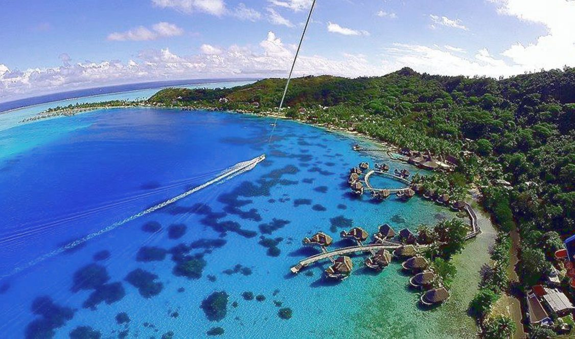 activity parasailing over bora bora famous lagoon during your vacation