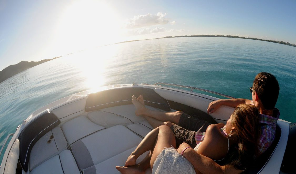 couple cruising photoshoot on the lagoon during private lover cruise in bora bora