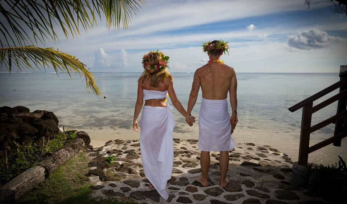 couple newly wed tahitian wedding at tiki village in moorea during vacation