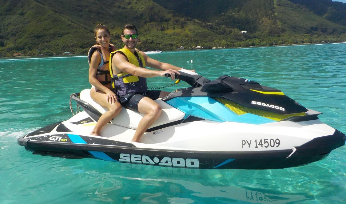 couple in jetski tour in Moorea French Polynesia during their vacation