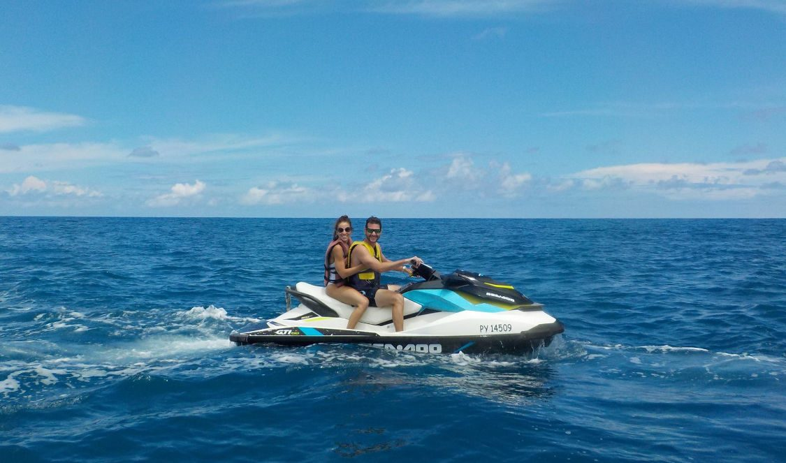 couple plain ocean at jetski tour in moorea during their vacation