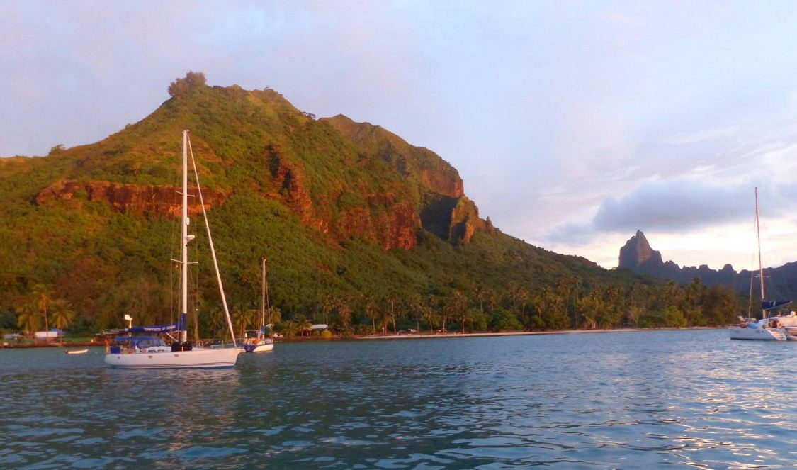 moorea mountains at sunset in moorea sunset cruise voila during a vacation