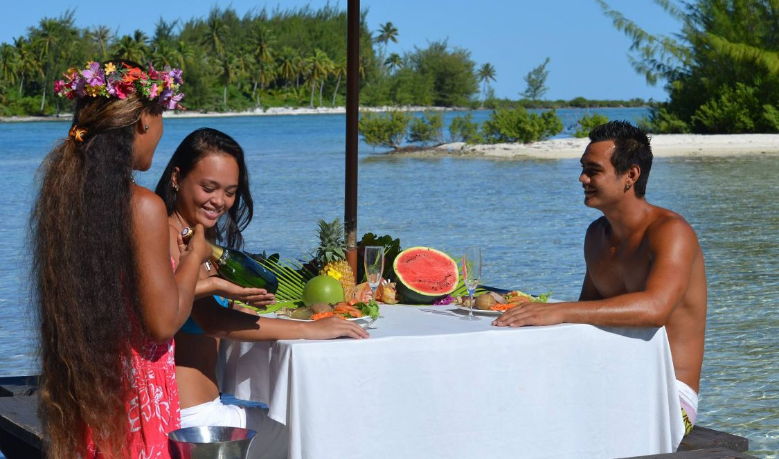 private lunch on an islet in  bora bora lagoon during vacation