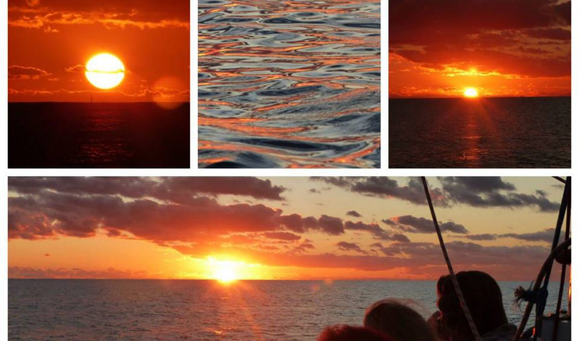 red orange sunsets in moorea sunset cruise voila during a holiday