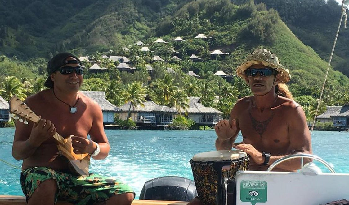 tahitian ukulele payed by local guides during moorea lagoon tour in Moorea French Polynesia